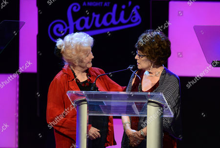 Actress Millicent Martin, left, presents the Sargent and Eunice Shriver profiles in dignity award to Jill Gascoine at the 21st Annual 'A Night at Sardi's' to benefit the Alzheimer's Association at the Beverly Hilton Hotel on in Beverly Hills, Calif