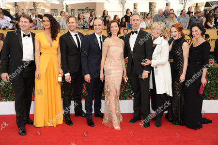 Derek Cecil, from left, Mozhan Marno, Jimmi Simpson, Michael Kelly, Molly Parker, Michael Gill, Jayne Atkinson, Rachel Brosnahan, and Joanna Going arrive at the 21st annual Screen Actors Guild Awards at the Shrine Auditorium, in Los Angeles