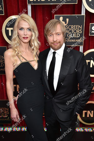Janne Tyldum, left, and Morten Tyldum arrive at the 21st annual Screen Actors Guild Awards at the Shrine Auditorium, in Los Angeles