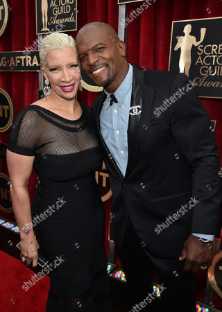 Rebecca Crews, left, and Terry Crews arrive at the 21st annual Screen Actors Guild Awards at the Shrine Auditorium, in Los Angeles