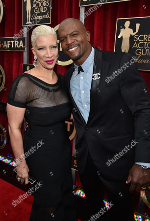 Stock Photo of Rebecca Crews, left, and Terry Crews arrive at the 21st annual Screen Actors Guild Awards at the Shrine Auditorium, in Los Angeles
