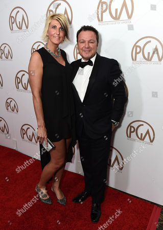 Christine Rogan, left, and Chad Oakes arrive at the 26th Annual Producers Guild Awards at the Hyatt Regency Century Plaza, in Los Angeles