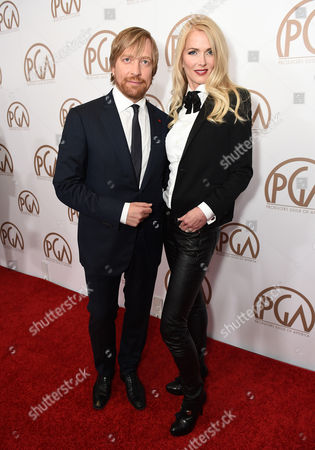 Morten Tyldum, left, and Janne Tyldum arrive at the 26th Annual Producers Guild Awards at the Hyatt Regency Century Plaza, in Los Angeles