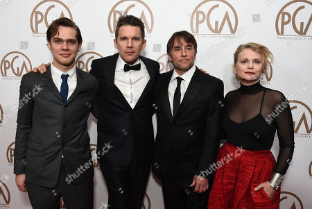 Ellar Coltrane, from left, Ethan Hawke, Richard Linklater, and Cathleen Sutherland arrive at the 26th Annual Producers Guild Awards at the Hyatt Regency Century Plaza, in Los Angeles
