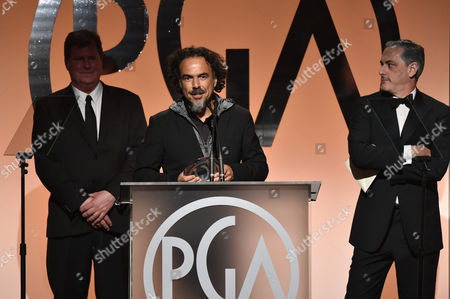 James W. Skotchdopole, and from left, Alejandro Gonzalez Inarritu, and John Lesher accept the Darryl F. Zanuck Award for outstanding producer of theatrical motion pictures for Birdmanon stage at the 26th Annual Producers Guild Awards at the Hyatt Regency Century Plaza, in Los Angeles