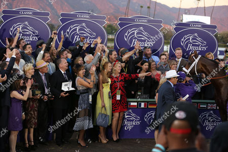 Stock Picture of Elizabeth Banks and President and CEO of Montblanc North America, Jan-Patrick Schmitz, center, are seen at the 30th Running of the Breeders' Cup World Championships Day 2, on in Arcadia, Calif