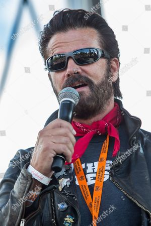Stock Photo of Lorenzo Lamas sings the National Anthem on stage during the 32nd Love Ride at Castaic Lake, in Castaic, Calif