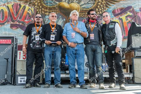 From left, actor Emilio Rivera, Love Ride founder Oliver Shokouh, Jay Leno, Lorenzo Lamas, and Robert Patrick on stage during the 32nd Love Ride at Castaic Lake, in Castaic, Calif