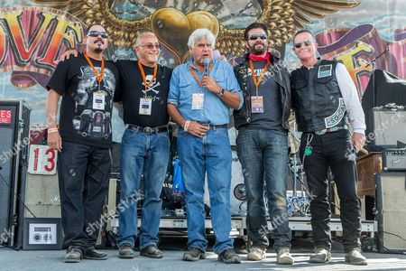From left, actor Emilio Rivera, Love Ride founder Oliver Shokouh, actors Jay Leno, Lorenzo Lamas, and Robert Patrick on stage during the 32nd Love Ride at Castaic Lake, in Castaic, Calif