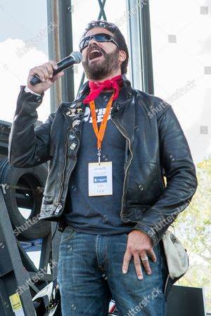 Lorenzo Lamas sings the national anthem on stage during the 32nd Love Ride at Castaic Lake, in Castaic, Calif