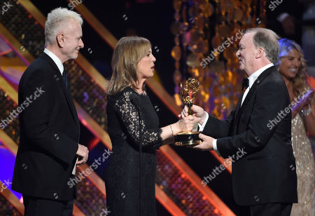 Stock Photo of Anthony Geary, left, and Genie Francis present Ken Corday with the award for outstanding drama series at the 42nd annual Daytime Emmy Awards at Warner Bros. Studios, in Burbank, Calif