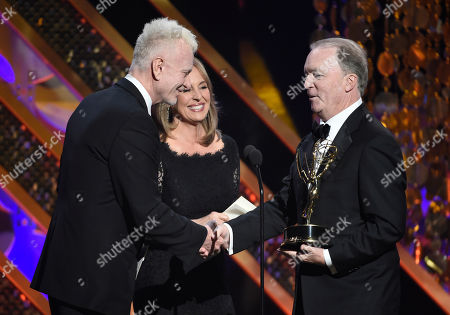 Anthony Geary, left, and Genie Francis present Ken Corday with the award for outstanding drama series at the 42nd annual Daytime Emmy Awards at Warner Bros. Studios, in Burbank, Calif