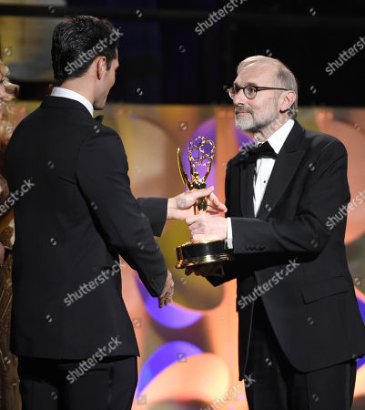 Ryan Paevey, left, presents Rand Morrison with the award for outstanding morning program for CBS Sunday Morning at the 42nd annual Daytime Emmy Awards at Warner Bros. Studios, in Burbank, Calif