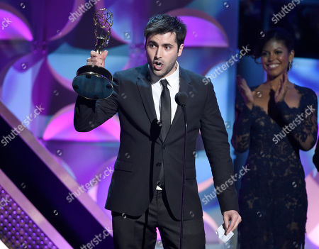 Freddie Smith accepts the award for outstanding younger actor in a drama series at the 42nd annual Daytime Emmy Awards at Warner Bros. Studios, in Burbank, Calif