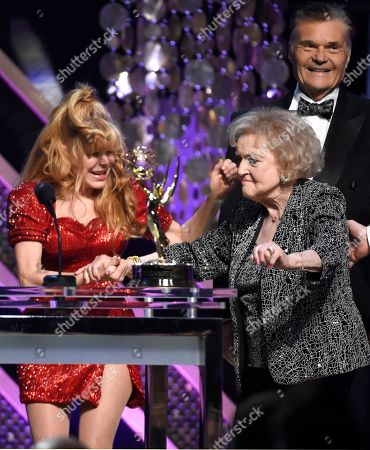 Charo, left, presents Betty White with the lifetime achievement award at the 42nd annual Daytime Emmy Awards at Warner Bros. Studios, in Burbank, Calif