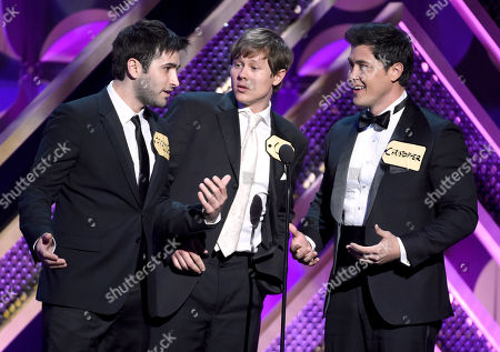 Freddie Smith, from left, Guy Wilson, and Christopher Sean present the award for outstanding game show at the 42nd annual Daytime Emmy Awards at Warner Bros. Studios, in Burbank, Calif
