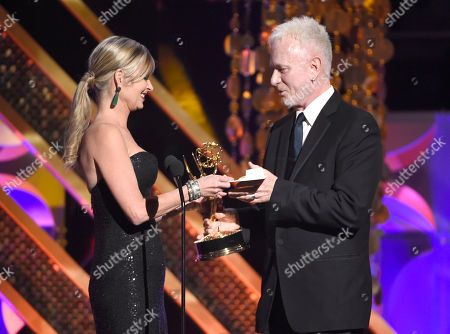 Eileen Davidson, left, presents Anthony Geary the award for outstanding lead actor in a drama series at the 42nd annual Daytime Emmy Awards at Warner Bros. Studios, in Burbank, Calif