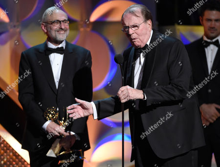 Rand Morrison, left, and Charles Osgood accept the award for outstanding morning program for CBS Sunday Morning at the 42nd annual Daytime Emmy Awards at Warner Bros. Studios, in Burbank, Calif