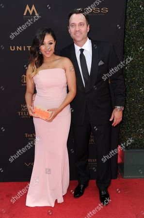 Tamera Mowry, left, and Adam Housley arrive at the 43rd annual Daytime Emmy Awards at the Westin Bonaventure Hotel, in Los Angeles