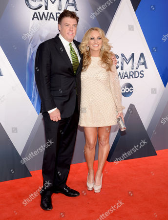 Frank Liddell, left, and Lee Ann Womack arrive at the 49th annual CMA Awards at the Bridgestone Arena, in Nashville, Tenn