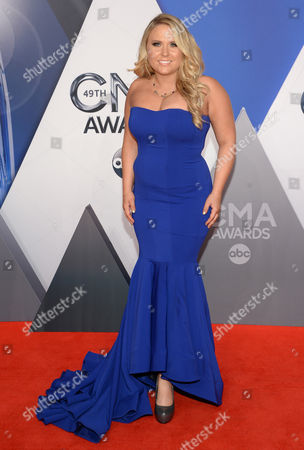 Stock Photo of Rachel Holder arrives at the 49th annual CMA Awards at the Bridgestone Arena, in Nashville, Tenn