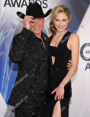 Clay Walker, left, and Jessica Walker arrive at the 49th annual CMA Awards at the Bridgestone Arena, in Nashville, Tenn