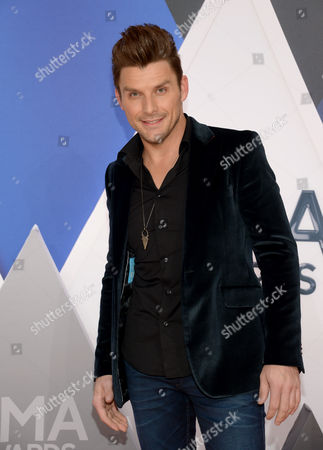 Robby Johnson arrives at the 49th annual CMA Awards at the Bridgestone Arena, in Nashville, Tenn