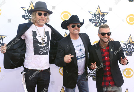 Big Kenny, left, and John Rich, center, of Big & Rich, and DJ Sinister arrive at the 50th annual Academy of Country Music Awards at AT&T Stadium, in Arlington, Texas