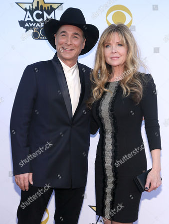 Clint Black, left, and Lisa Hartman arrive at the 50th annual Academy of Country Music Awards at AT&T Stadium, in Arlington, Texas
