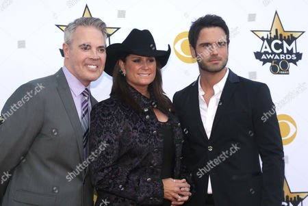 Blair Garner, from left, Terri Clark and Chuck Wicks arrive at the 50th annual Academy of Country Music Awards at AT&T Stadium, in Arlington, Texas