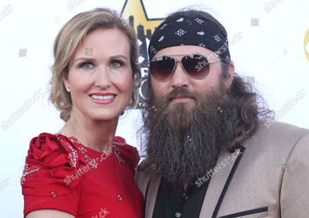"""Korie Robertson, left, and Willie Robertson from """"Duck Dynasty"""" arrive at the 50th annual Academy of Country Music Awards at AT&T Stadium, in Arlington, Texas"""