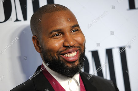 Stock Photo of Claude Kelly arrives at the 62nd Annual BMI Pop Awards at the Beverly Wilshire Hotel, in Beverly Hills, Calif