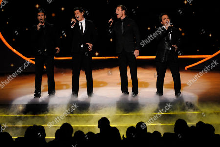 SEPTEMBER 18: The Canadian Tenors perform onstage at the Academy of Television Arts & Sciences 63rd Primetime Emmy Awards at Nokia Theatre L.A. Live on in Los Angeles, California