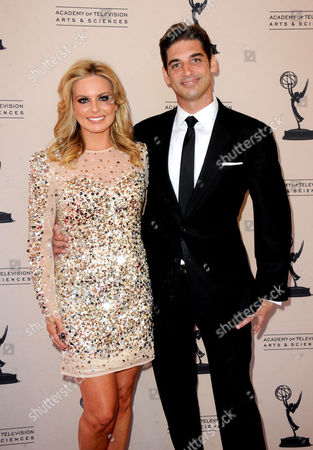 AUGUST 11: Courtney Friel (L) and guest arrive at the Academy of Television Arts & Sciences 64th Los Angeles Area Emmy Awards on in Los Angeles, California