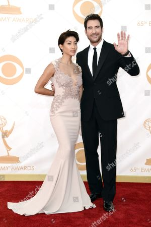 Shasi Wells, left, and Dylan McDermott, right, arrive at the 65th Primetime Emmy Awards at Nokia Theatre, in Los Angeles