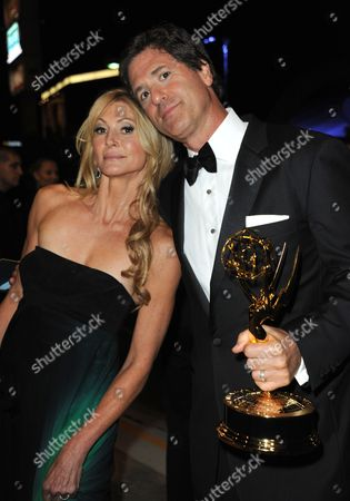 """Krista Levitan, left, and Steven Levitan, winner of the award for outstanding comedy series for """"Modern Family,"""" pose for photos at the Governors Ball at the 65th Primetime Emmy Awards at the Nokia Theatre, in Los Angeles"""