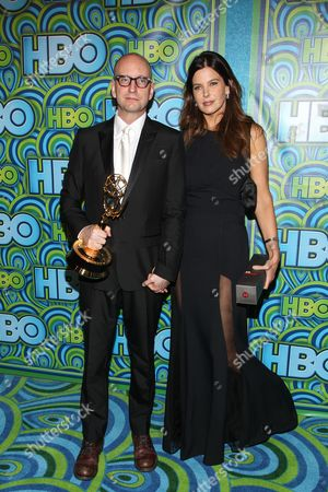 Director Steven Soderbergh (L) and Jules Asner arrive at the HBO Primetime Emmy's After Party at The Plaza at the Pacific Design Center on in Los Angeles