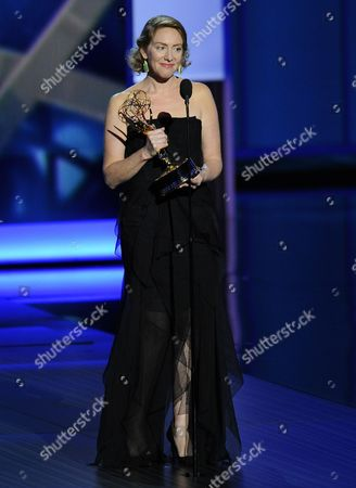 Sarah Bromell accepts the award for outstanding writing for a drama series on behalf of her late husband, Henry Bromell, for his work on Homeland at the 65th Primetime Emmy Awards at Nokia Theatre, in Los Angeles