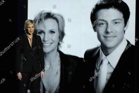 Jane Lynch presents a tribute to Cory Monteith on stage at the 65th Primetime Emmy Awards at Nokia Theatre, in Los Angeles. Monteith died on July 13