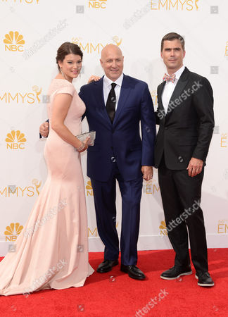 Stock Photo of Gail Simmons, and from left, Tom Colicchio and Hugh Acheson arrive at the 66th Primetime Emmy Awards at the Nokia Theatre L.A. Live, in Los Angeles