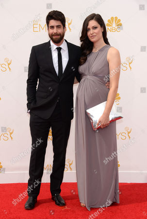 Roxanne Daner, left, and Adam Goldberg arrive at the 66th Primetime Emmy Awards at the Nokia Theatre L.A. Live, in Los Angeles