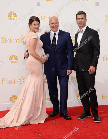 Stock Image of Gail Simmons, and from left, Tom Colicchio and Hugh Acheson arrive at the 66th Primetime Emmy Awards at the Nokia Theatre L.A. Live, in Los Angeles