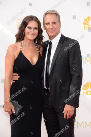 Chelsea Field, left, and Scott Bakula arrive at the 66th Primetime Emmy Awards at the Nokia Theatre L.A. Live, in Los Angeles