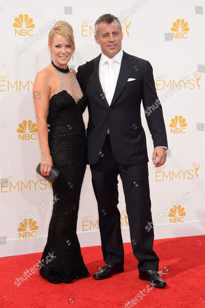 Andrea Anders, left, and Matt LeBlanc arrive at the 66th Primetime Emmy Awards at the Nokia Theatre L.A. Live, in Los Angeles