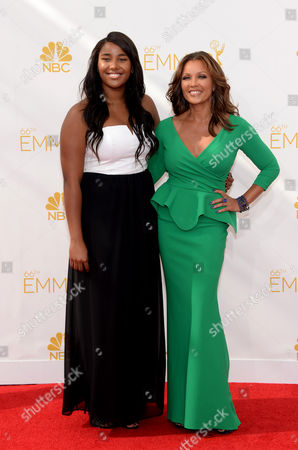 Jillian Hervey, left, and Vanessa L. Williams arrive at the 66th Primetime Emmy Awards at the Nokia Theatre L.A. Live, in Los Angeles