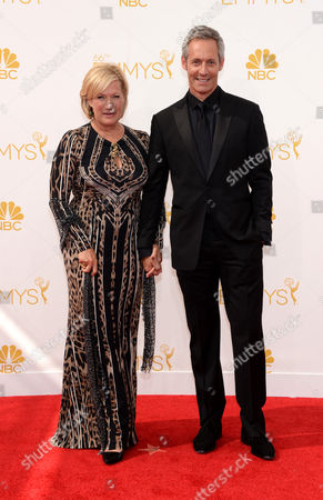 Jayne Atkinson, left, and Michael Gill arrive at the 66th Primetime Emmy Awards at the Nokia Theatre L.A. Live, in Los Angeles