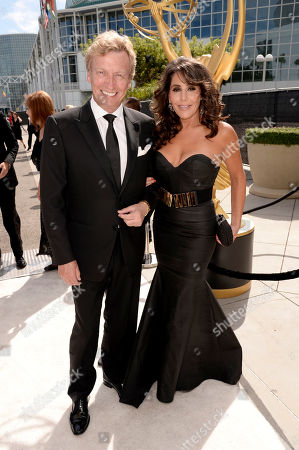 Stock Image of Nigel Lythgoe, left, and Bonnie Lythgoe arrive at the 66th Primetime Emmy Awards at the Nokia Theatre L.A. Live, in Los Angeles