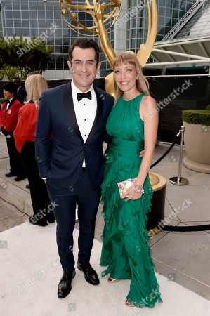 Ty Burrell, left, and Holly Anne Brown arrive at the 66th Primetime Emmy Awards at the Nokia Theatre L.A. Live, in Los Angeles