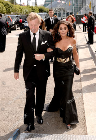 Nigel Lythgoe, left, and Bonnie Lythgoe arrive at the 66th Primetime Emmy Awards at the Nokia Theatre L.A. Live, in Los Angeles
