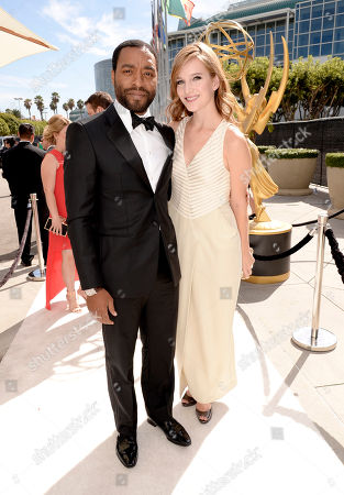 Chiwetel Ejiofor, left, and Sari Mercer arrive at the 66th Primetime Emmy Awards at the Nokia Theatre L.A. Live, in Los Angeles
